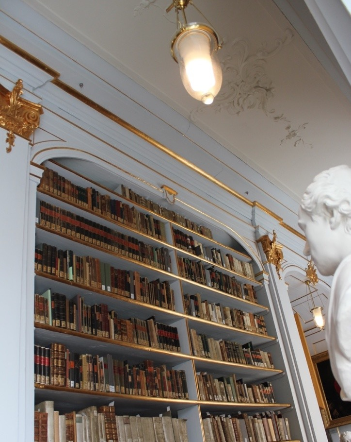 The splendid Rococo style of one of the bookshelves at the Anna Amalia library in Weimar.