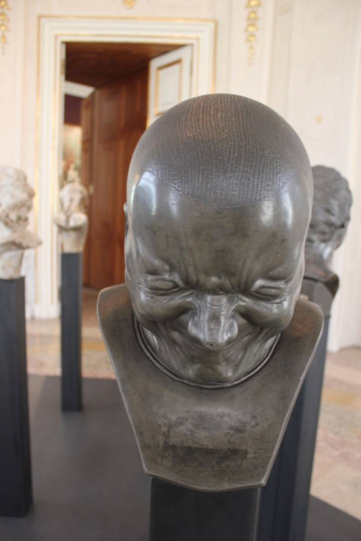 """The front of Messerschmidt's bust """"Erzbösewicht"""" (translated that means arch villain). We can see the extreme power of the expression. The dark metal shines in the light corner room of the Upper Belvedere."""