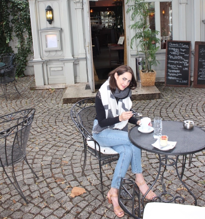 Enjoying a cup of coffee outside an old coffeehouse in Weimar.