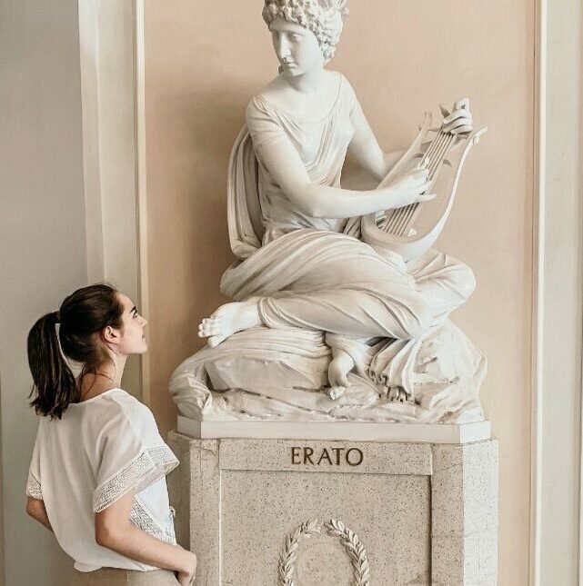 In front of the sculpture of the muse Erato